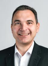 Dr. Adrian Schuster